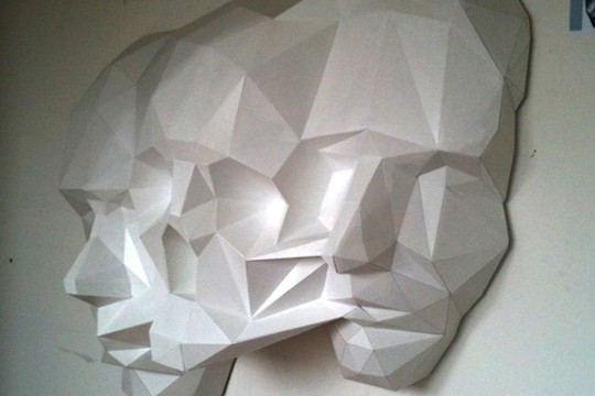 Massive 3D Puzzle-Like Sculpture Depicting Angular Faces Of Life And Death